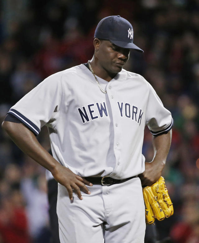 New York Yankees starting pitcher Michael Pineda walks off the mound after being ejected when a foreign substance was discovered on his neck, in the second inning of a baseball game against the Boston Red Sox at Fenway Park in Boston, Wednesday, April 23, 2014. (AP Photo/Elise Amendola)