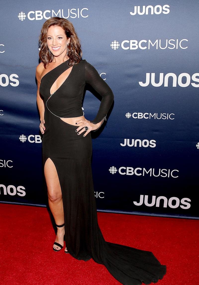 Host Sarah McLachlan in a dress that looks excessively difficult to walk in.