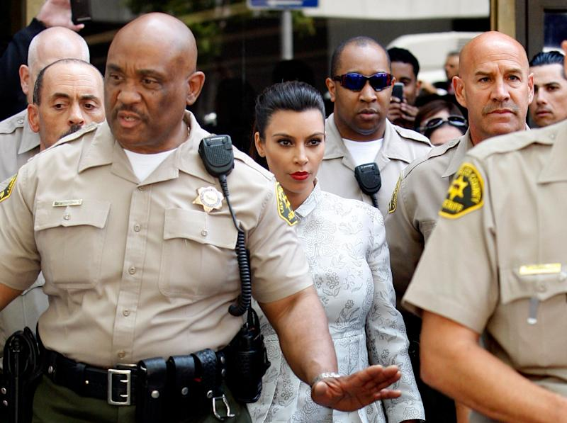 LOS ANGELES, CA - APRIL 12: Kim Kardashian surrounded by Los Angeles County Sheriff Deputies leaves the Stanley Mosk Courthouse after attending her divorce hearing from Kris Humphries on April 12, 2013 in Los Angeles, California. Kim Kardashian and NBA player Kris Humphries are appearing for divorce proceedings. Humphries is seeking an annulment of their ten-week marriage, claiming it was based on fraud. (Photo by David McNew/Getty Images)