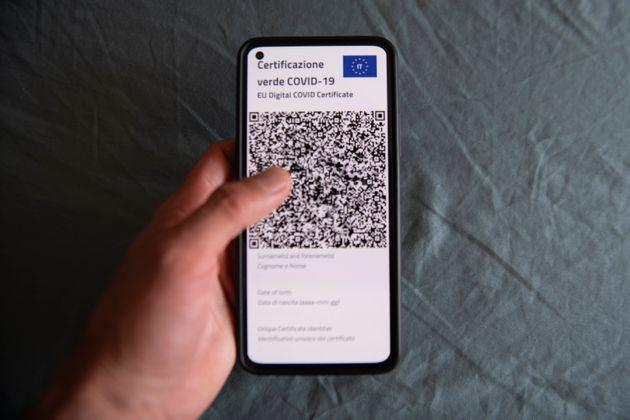 TURIN, ITALY - JUNE 30: A person operates Italy's Covid-19 Green Pass for post-vaccine travel on a smartphone on June 30, 2021 in Turin, Italy. The digital health certificate, or Green Pass, was officially launched by Italian Prime Minister Draghi, allowing people to access certain events and facilities in Italy as well as travel domestically and abroad. (Photo by Stefano Guidi/Getty Images) (Photo: Stefano Guidi via Getty Images)