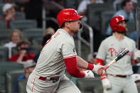 Philadelphia Phillies' Rhys Hoskins (17) hits a solo home run in the fourth inning of a baseball game against the Atlanta Braves Sunday, April 11, 2021, in Atlanta. (AP Photo/John Bazemore)
