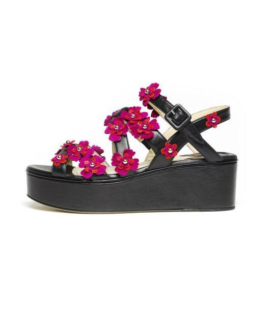 """<p>Lotus floral wedge, price upon request, <a href=""""https://paulandrew.com/products/lotus-floral-wedge-962-na20"""" rel=""""nofollow noopener"""" target=""""_blank"""" data-ylk=""""slk:Paul Andrew"""" class=""""link rapid-noclick-resp"""">Paul Andrew</a></p>"""