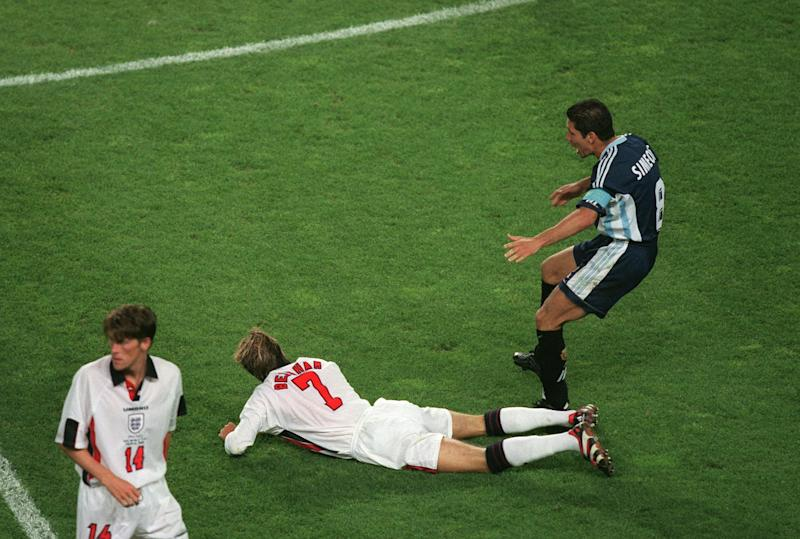 30 June 1998 - World Cup round of sixteen - Argentina v England, David Beckham aims a kick at Diego Simeone. (Photo by Mark Leech/Getty Images)
