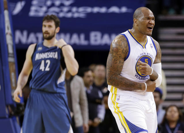 Golden State Warriors' Marreese Speights (5) reacts after scoring and getting could next to Minnesota Timberwolves' Kevin Love (42) during the first half of an NBA basketball game on Monday, April 14, 2014, in Oakland, Calif. (AP Photo/Marcio Jose Sanchez)