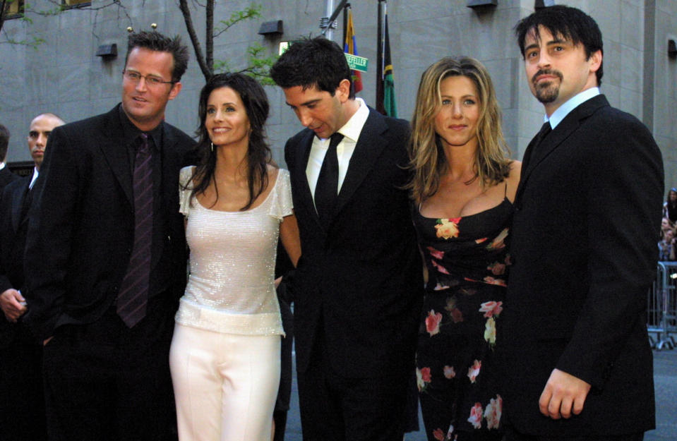 "FILE - In this May 5, 2002 file photo, the cast members, Matthew Perry, from left, Courteney Cox Arquettte, David Schwimmer, Jennifer Aniston and Matt LeBlanc of the television show ""Friends,"" arrive at New York's Rockefeller Center for NBC's 75th Anniversary event. Netflix will still be there for fans of the old TV series ""Friends,"" but maintaining the relationship will come at a steep price. The New York Times reported that Netflix paid $100 million to keep showing ""Friends"" on its U.S. service through 2019. (AP Photo/Tina Fineberg, File)"