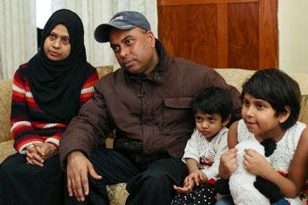 MD Chowdhury sits in his living room with his wife, Nazneen Fatema, and daughters, Nafia, 2, and Nabiha (R), 7, during an interview about lead safety improvements made to their lead contaminated home in Buffalo, New York March 30, 2017.  REUTERS/Lindsay DeDario