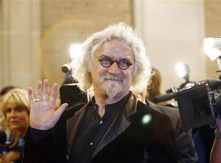 Billy Connolly waves at the premiere of Fido at the 31st Toronto International Film Festival in Toronto
