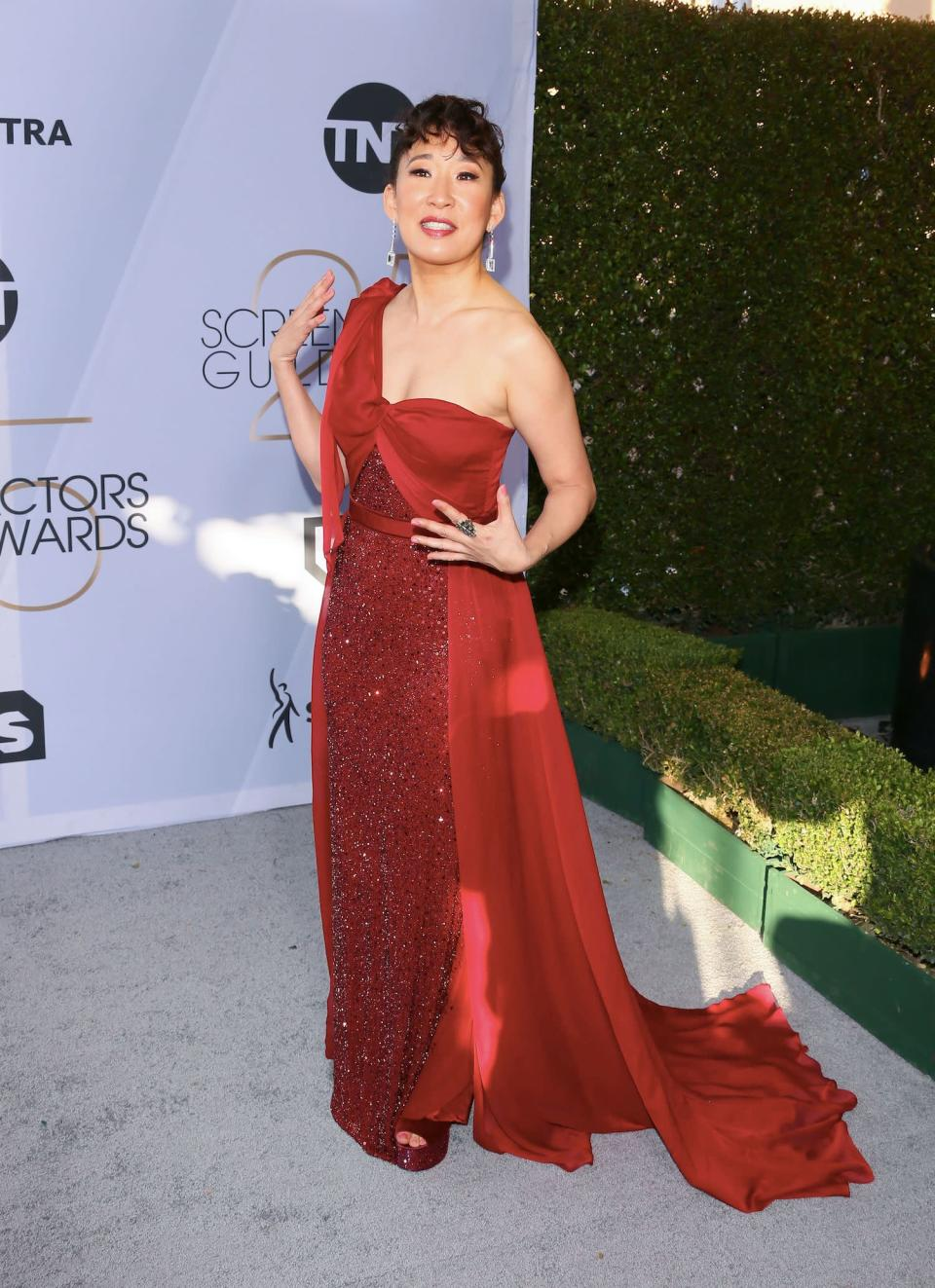 <p>After co-hosting the 2019 Golden Globe Awards, Sandra Oh — rocking a red one-shoulder Jenny Packham gown — got to sit back and enjoy this show. (Photo: Getty Images) </p>