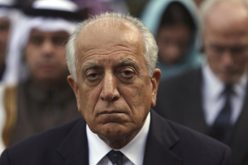 """FILE - In this March 9, 2020, file photo, Washington's peace envoy Zalmay Khalilzad, attends Ashraf Ghani's inauguration ceremony at the presidential palace in Kabul, Afghanistan. The Taliban put the son of the movement's feared founder in charge of its military wing and added powerful figures to its negotiating team ahead of expected talks aimed at ending Afghanistan's decades of war, Taliban officials say. On Monday, July 13, 20202, four-and-a-half months since the signing, Khalilzad tweeted that """"a key milestone in the implementation of the U.S.-Taliban agreement"""" had been reached as American troop numbers dropped to 8,600 from about 12,000 and five bases were closed. (AP Photo/Rahmat Gul, File)"""
