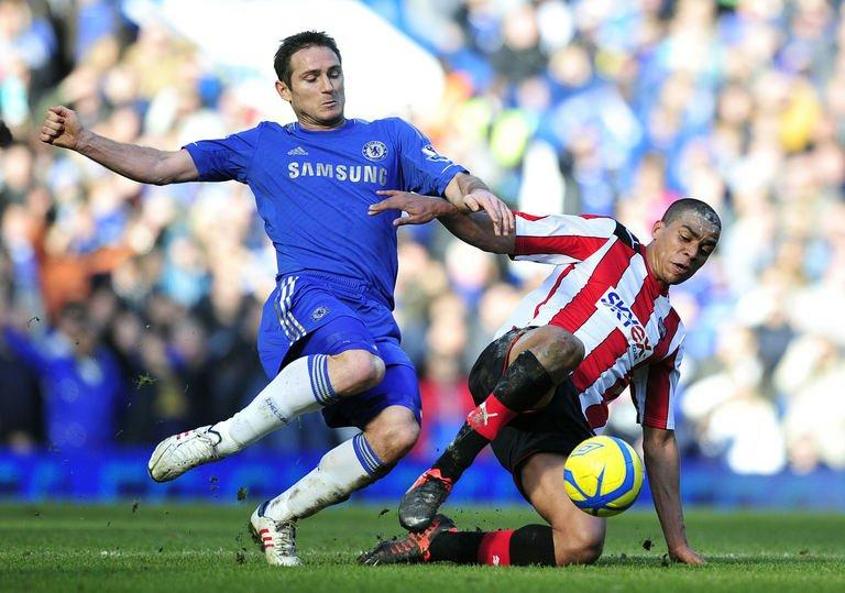 Frank Lampard (left) vies with Brentford's Tom Adeyemi during the match in London on February 17, 2013