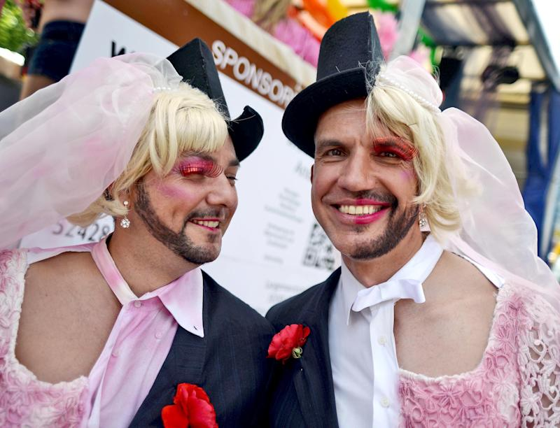 Participants of the Christopher Street Day gay pride parade pose on July 6, 2014 in Cologne, Germany