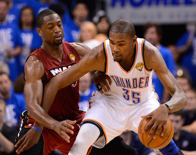 OKLAHOMA CITY, OK - JUNE 12: Kevin Durant #35 of the Oklahoma City Thunder posts up Dwyane Wade #3 of the Miami Heat in the fourth quarter in Game One of the 2012 NBA Finals at Chesapeake Energy Arena on June 12, 2012 in Oklahoma City, Oklahoma. NOTE TO USER: User expressly acknowledges and agrees that, by downloading and or using this photograph, User is consenting to the terms and conditions of the Getty Images License Agreement. (Photo by Ronald Martinez/Getty Images)