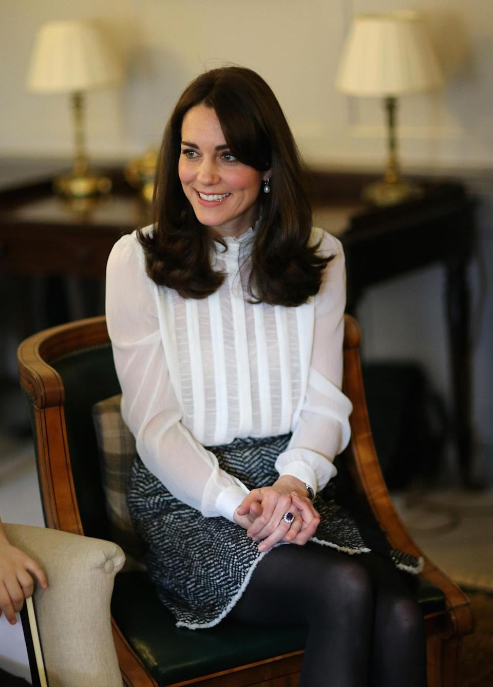 <p>Dressed in a vintage-inspired blouse from Reiss and a boucle wool skirt by Dolce & Gabbana, Kate launched the Young Minds Matter initiative. Black tights and Stuart Weitzman heels finished off the outfit.</p><p><i>[Photo: PA]</i></p>