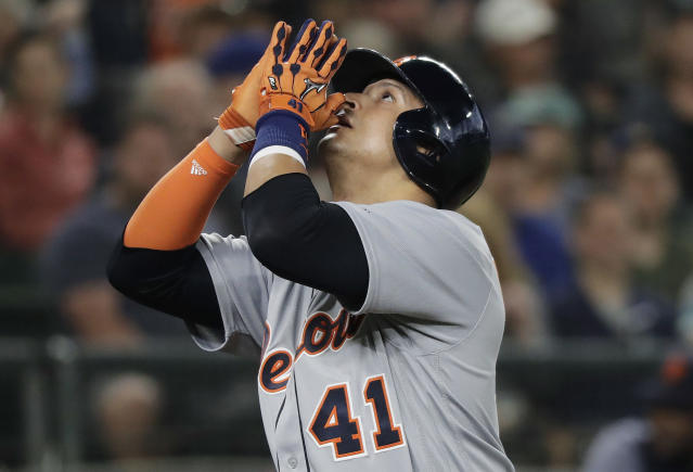 Detroit Tigers' Victor Martinez gestures as he scores on a solo home run against the Seattle Mariners during the second inning of a baseball game Saturday, May 19, 2018, in Seattle. (AP Photo/Ted S. Warren)