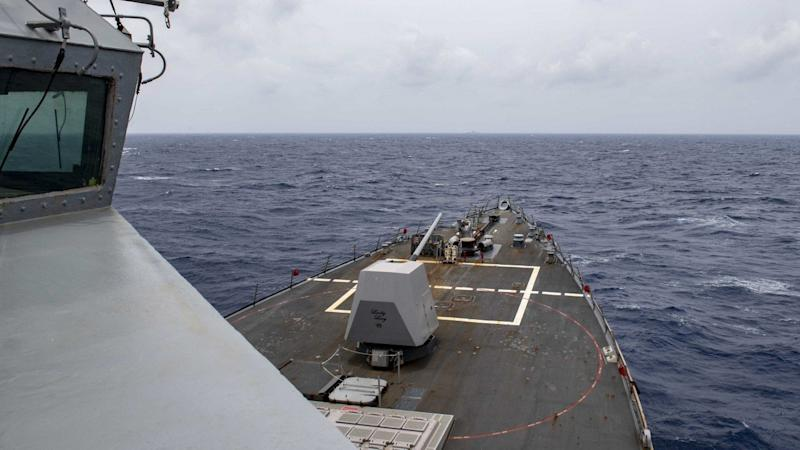 Beijing claims it has warned a US destroyer in South China Sea after missile launch