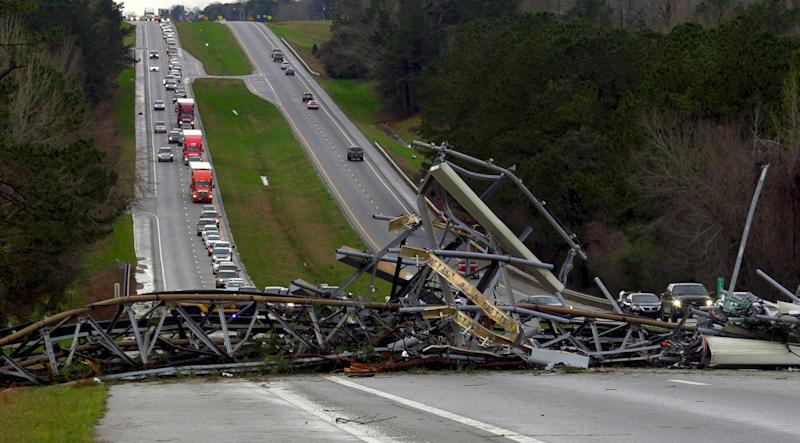 A fallen cell tower lies across U.S. Route 280 highway in Lee County, Ala., in the Smiths Station community after what appeared to be a tornado struck in the area, March 3, 2019. Severe storms destroyed mobile homes, snapped trees and left a trail of destruction amid weather warnings extending into Georgia, Florida and South Carolina, authorities said. (Photo: Mike Haskey/Ledger-Enquirer via AP)
