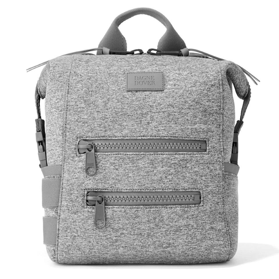 """For anyone concerned their man would be hesitant to tote a tote, the diaper backpack is your answer. If it weren't for the wet wipes, binkies, and burp cloths tucked away inside, this Dagne Dover number would easily pass as a commuter's backpack or even gym bag. It's made of soft neoprene, comes in gender-neutral colors, and has plenty of pouches (because tiny baby gear requires tiny baby compartments). Apart from the sporty design, the best part is it comes with its own matching changing mat and anchors for your stroller. —<em>S.S.</em> $155, Dagne Dover. <a href=""""https://www.dagnedover.com/collections/indi-diaper-backpack"""" rel=""""nofollow noopener"""" target=""""_blank"""" data-ylk=""""slk:Get it now!"""" class=""""link rapid-noclick-resp"""">Get it now!</a>"""