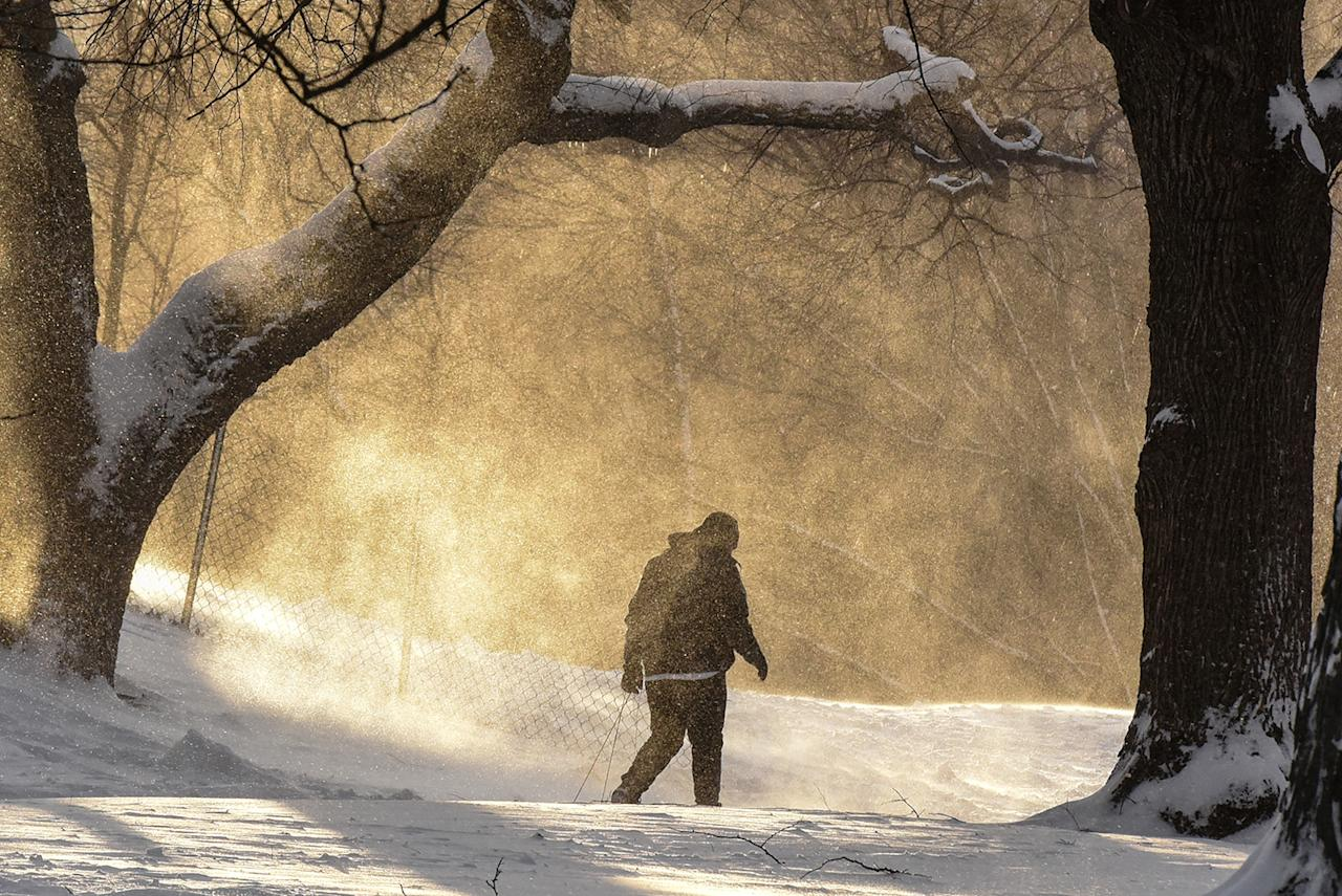 <p>A person walks through Fort Greene Park in the Brooklyn borough of New York, during winter storm, Feb. 9, 2017. (Photo: Stephanie Keith/Reuters) </p>
