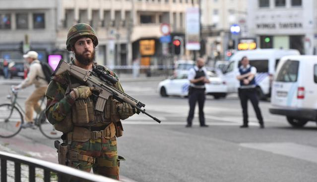 <p>A Belgian Army soldier stands outside Central Station after a reported explosion in Brussels on Tuesday, June 20, 2017. Belgian media are reporting that explosion-like noises have been heard at a Brussels train station, prompting the evacuation of a main square. (AP Photo/Geert Vanden Wijngaert) </p>