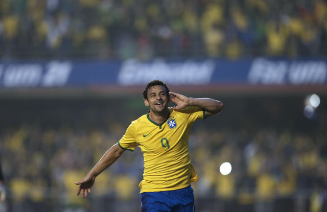 Brazil's Fred celebrates after scoring against Serbia during a friendly soccer match at Morumbi stadium in Sao Paulo, Brazil, Friday, June 6, 2014. Brazil is hosting the World Cup soccer tournament that starts June 12. (AP Photo/Andre Penner)