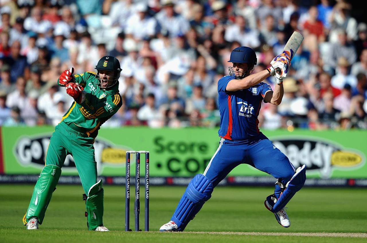 NOTTINGHAM, ENGLAND - SEPTEMBER 05: Craig Kieswetter of England hits out to the boundary in front of AB de Villiers of South Africa during the 5th NatWest Series ODI match England and South Africa at Trent Bridge on September 5, 2012 in Nottingham, England.  (Photo by Laurence Griffiths/Getty Images)