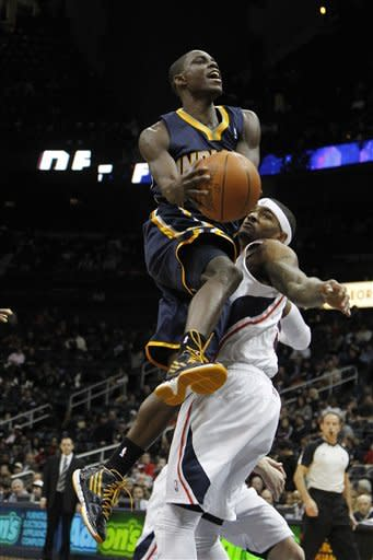 Indiana Pacers guard Darren Collison (2) drives against Atlanta Hawks forward Josh Smith (5) in the first quarter of an NBA basketball game Wednesday, Feb. 8, 2012 in Atlanta. (AP Photo/John Bazemore)