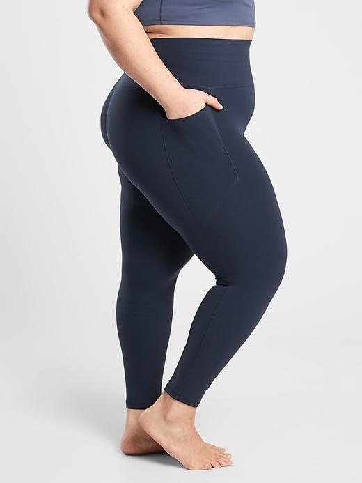 """<p>Kelsey Gephart, a Club Pilates master trainer in Jupiter, FL, is obsessed with the <span>Athleta Salutation Stash Pocket II Tight</span> ($98). """"They are the perfect rise and have a nice thick waistband, so they don't pinch but also stay put while I teach,"""" Gephart told POPSUGAR. """"Also, the pocket is totally clutch. This chapstick addict can keep it so close by!""""</p>"""