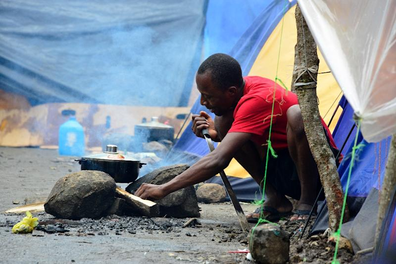 A makeshift camp in Costa Rica's Penas Blancas, close to the border with Nicaragua, houses hundreds of Haitians, Congolese, Senegalese and Ghanahian migrants who are all waiting to continue their journey to the United States (AFP Photo/Ezequiel Becerra)