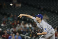 Kansas City Royals starting pitcher Homer Bailey throws to a Seattle Mariners batter during the sixth inning of a baseball game Tuesday, June 18, 2019, in Seattle. (AP Photo/Elaine Thompson)