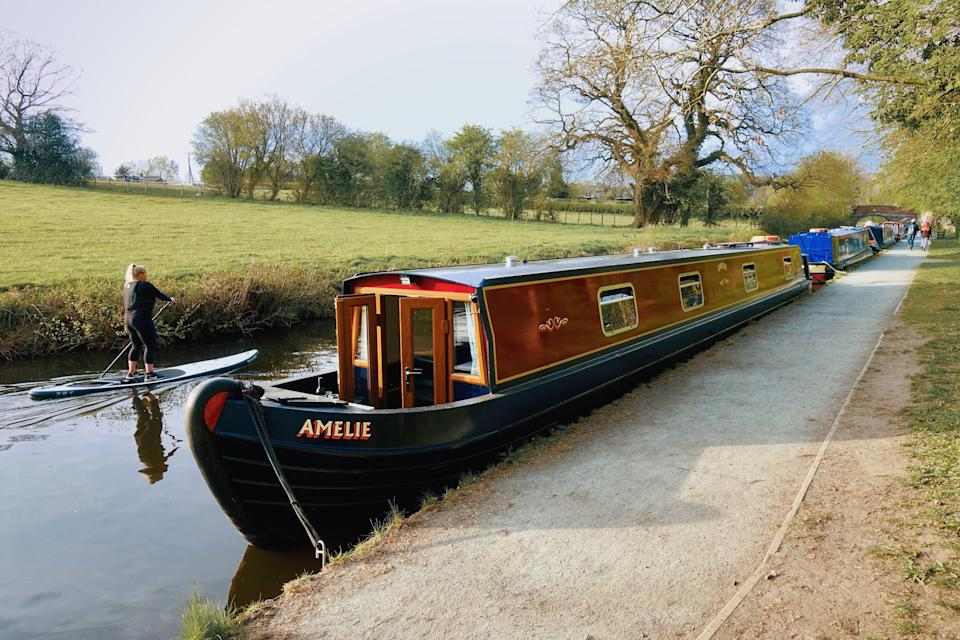 <p>Trying to steer a 62ft two-bedroom narrowboat takes a fair amount of concentration</p> (Adam Batterbee)