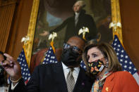 House Speaker Nancy Pelosi of Calif., talks with Rep. Troy Carter, D-La., following a ceremonial swearing-in on Capitol Hill in Washington, Tuesday, May 11, 2021. (AP Photo/Susan Walsh)