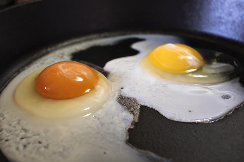 FILE - This undated photo shows the darker orange yolk of a homegrown chicken egg, left, compared with the lighter yolk of a store-bought egg in Gillette, Wyo. Yolk color is primarily determined by the carotenoids _ naturally occurring pigments in plants _ that hens eat, according to Elizabeth Bobeck, a poultry nutrition professor at Iowa State University. (Pete Rodman/Gillette News Record via AP)