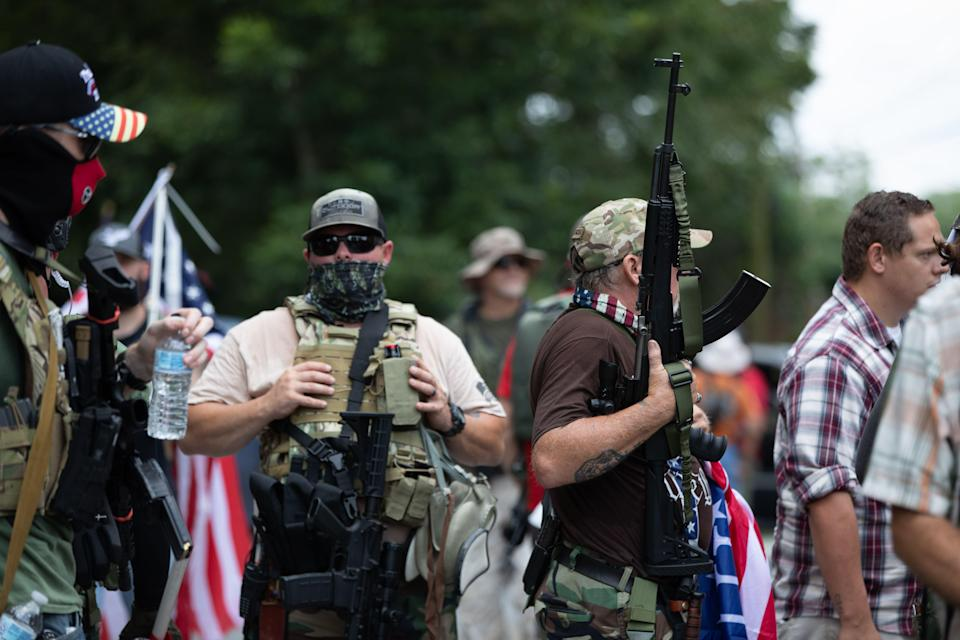 Members of far-right militias and white pride organizations rally in Stone Mountain, Ga., on Saturday. (Logan Cyrus/AFP via Getty Images)