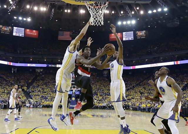 McGee's length and athleticism have long made him a gifted shot-blocker, but he's also taken strides as a team defender in his first year as a Warrior. (AP)