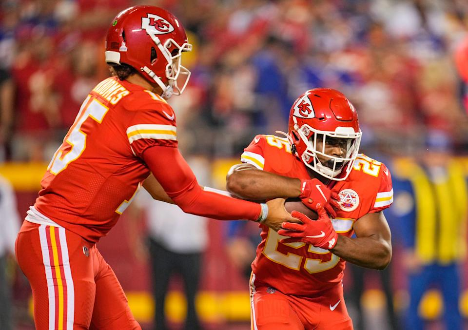 Kansas City Chiefs quarterback Patrick Mahomes (15) hands off to running back Clyde Edwards-Helaire (25) during the first half against the Buffalo Bills at GEHA Field at Arrowhead Stadium.