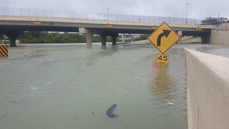 A partially submerged highway sign in Houston. (David Lohr/HuffPost)