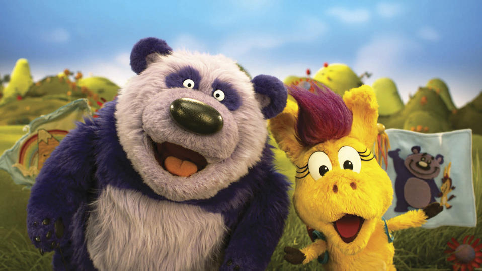 "This image released by PBS Kids shows puppet characters Purple Panda, left, and Donkey Hodie from the new series, ""Donkey Hodie,"" inspired from characters in the original Fred Rogers TV show. The whimsical series for children ages 3-5 starts airing Monday and centers on the adventures of Donkey Hodie, an enthusiastic yellow donkey with a bright magenta mane. (Fred Rogers Productions/PBS Kids via AP)"
