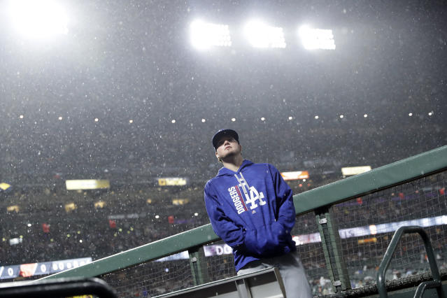 Los Angeles Dodgers' Alex Verdugo looks up at the rain during a delay during a baseball game against the San Francisco Giants, Monday, Sept. 11, 2017, in San Francisco. (AP Photo)