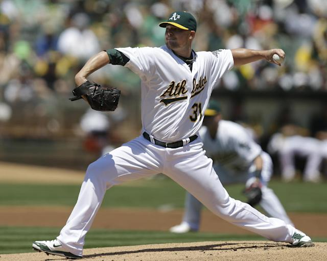 Oakland Athletics' Jon Lester works against the Kansas City Royals in the first inning of a baseball game Saturday, Aug. 2, 2014, in Oakland, Calif. (AP Photo/Ben Margot)