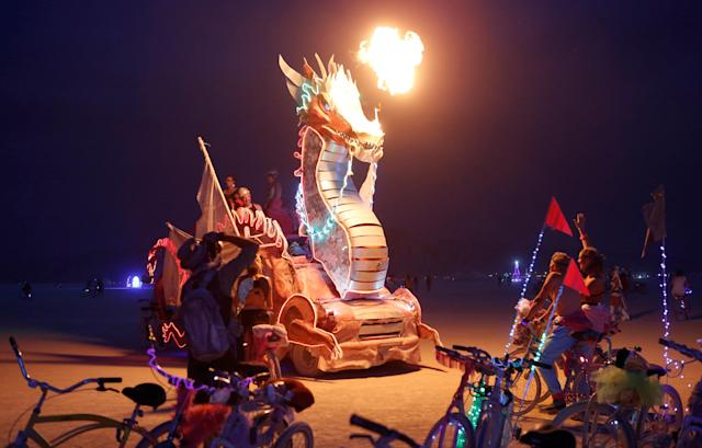 <p>Participants ride a mutant vehicle as approximately 70,000 people from all over the world gathered for the annual Burning Man arts and music festival in the Black Rock Desert of Nevada, Aug. 30, 2017. (Photo: Jim Urquhart/Reuters) </p>