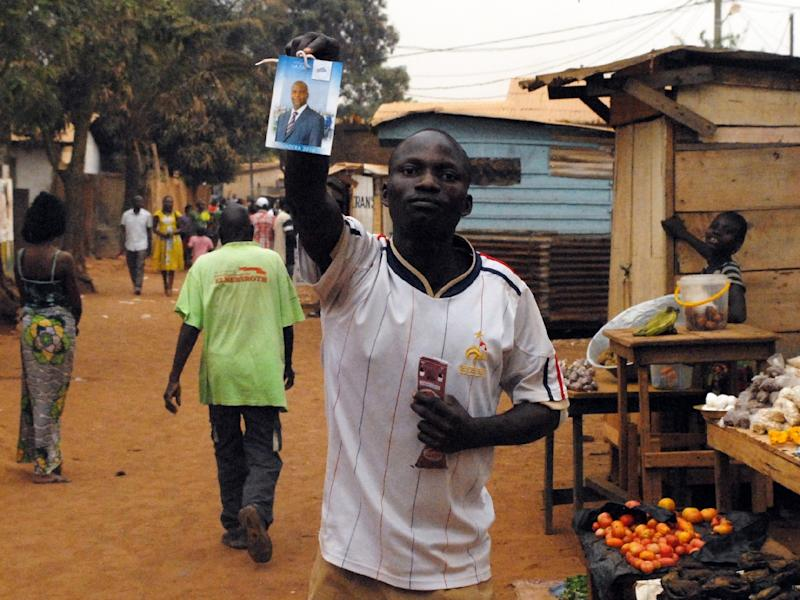A supporter of Central African's new president Faustin-Archange Touadera as he celebrates his victory in the streets of Bangui on February 20, 2016 (AFP Photo/Pacome Pabandji)