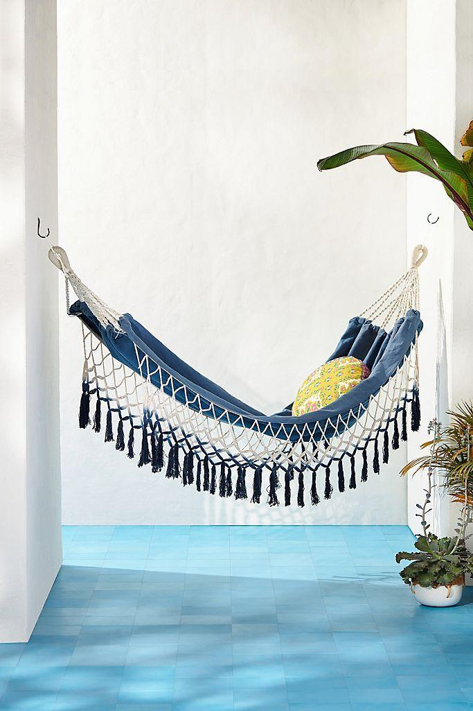 """<p><strong>Anthropologie</strong></p><p>anthropologie.com</p><p><strong>$128.00</strong></p><p><a href=""""https://go.redirectingat.com?id=74968X1596630&url=https%3A%2F%2Fwww.anthropologie.com%2Fshop%2Fclear-skies-hammock&sref=https%3A%2F%2Fwww.countryliving.com%2Fshopping%2Fg30983323%2Fbest-hammocks%2F"""" rel=""""nofollow noopener"""" target=""""_blank"""" data-ylk=""""slk:Shop Now"""" class=""""link rapid-noclick-resp"""">Shop Now</a></p><p>Add a pop of color to your patio with this comfy cotton fringed hammock. All you need is some patterned pillows, a good book, and a glass of lemonade for a picturesque afternoon outside.</p>"""