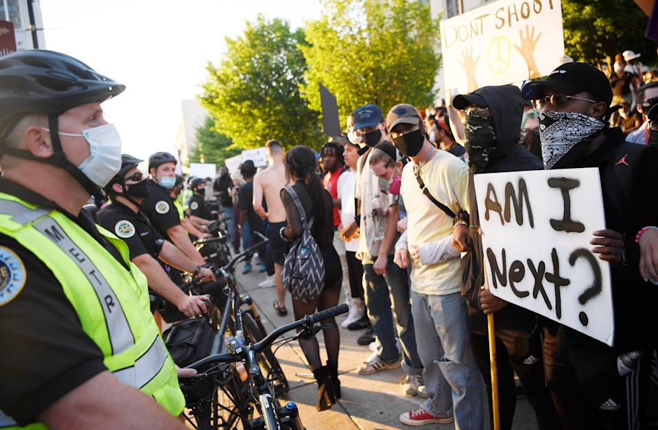 "Metro Nashville Police and protesters face off outside Metro Courthouse in Nashville, Tennessee, on May 30, 2020, after the ""I Will Breathe"" rally to protest the death of George Floyd, an unarmed black man who died after being pinned down by a white Minneapolis police officer."
