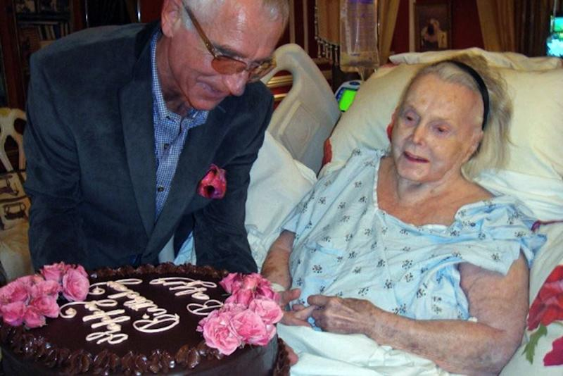 FILE - In this Feb. 6, 2011 file photo provided by John Blanchette, Zsa Zsa Gabor is seen in her Bel Air mansion in Los Angeles with her husband, Frederic von Anhalt, while celebrating her 94th birthday. A judge on Wednesday Jan. 9, 2013 extended a conservatorship over the ailing actress until August and ordered her husband to provide an accounting of her finances.  (AP Photo/John Blanchette, File)