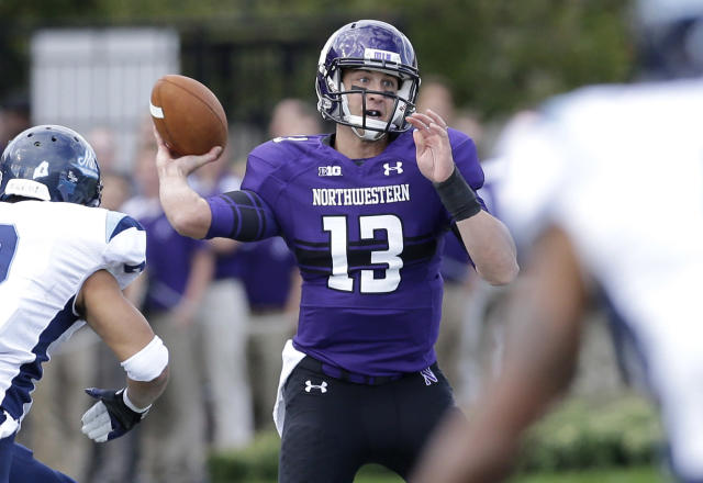 Northwestern quarterback Trevor Siemian (13) looks to pass during the first half of an NCAA college football game against Maine in Evanston, Ill., Saturday, Sept. 21, 2013. (AP Photo/Nam Y. Huh)