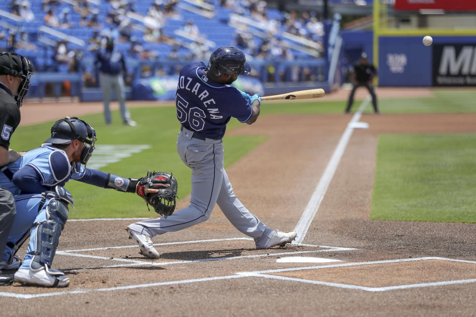 Tampa Bay Rays' Randy Arozarena (56) doubles in front of Toronto Blue Jays catcher Danny Jansen during the first inning of a baseball game Sunday, May 23, 2021, in Dunedin, Fla. (AP Photo/Mike Carlson)