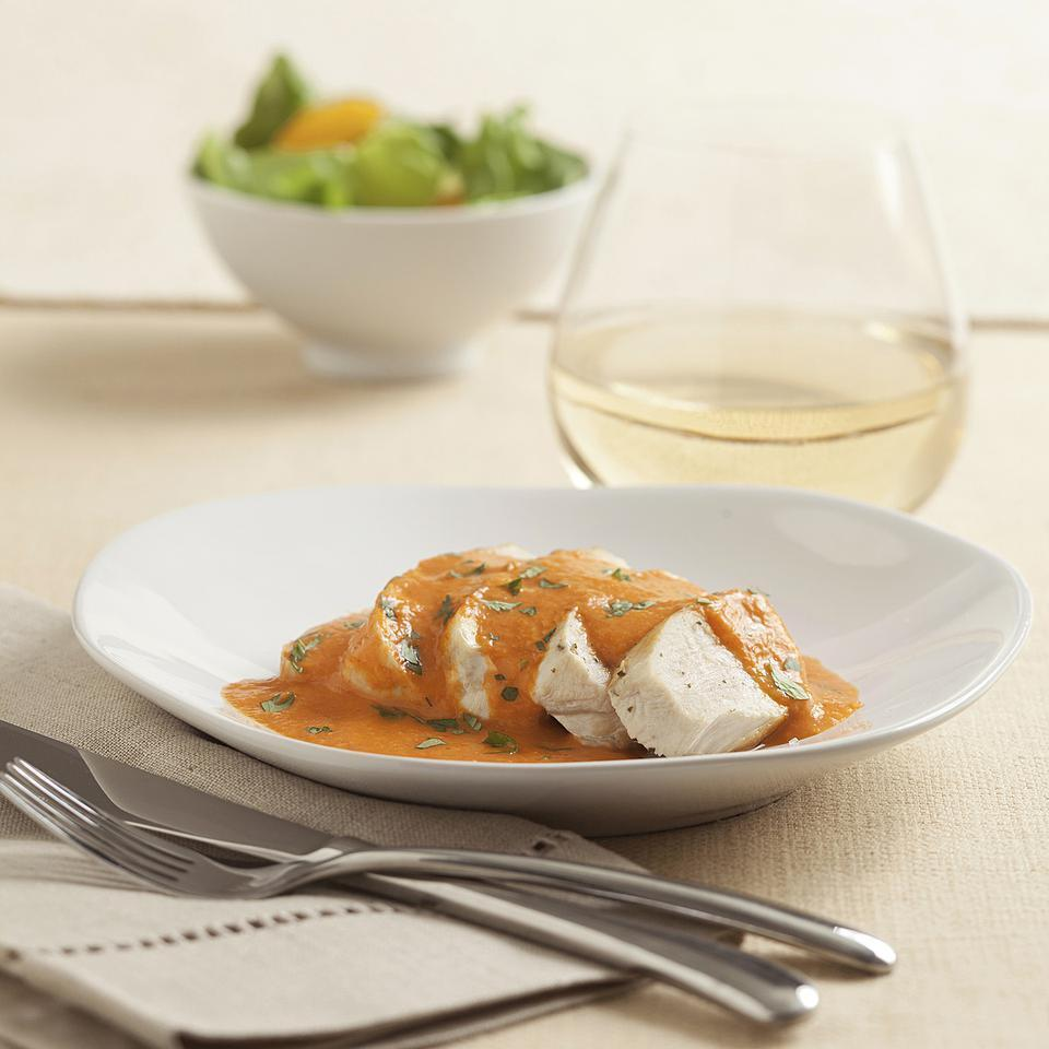 """<p>In this healthy chicken with red pepper cream sauce recipe, roasted red pepper and chipotle give this creamy sauce a beautiful red hue and give it a slightly sweet and smoky flavor. The sauce can be made ahead, then served with seared chicken, as we do in this recipe, or with grilled fish or ravioli. This recipe makes more Cream Sauce without the Cream than you'll need for the red pepper sauce. Refrigerate or freeze the extra sauce and use it in place of heavy cream in any sauce or soup that calls for cream. <a href=""""http://www.eatingwell.com/recipe/250632/chicken-with-red-pepper-cream-sauce/"""" rel=""""nofollow noopener"""" target=""""_blank"""" data-ylk=""""slk:View recipe"""" class=""""link rapid-noclick-resp""""> View recipe </a></p>"""
