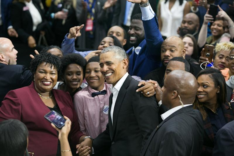 Former US President Barack Obama (C) and Georgia Democratic Gubernatorial candidate Stacey Abrams (L) pose for a photo during a campaign rally in Atlanta, Georgia ahead of Tuesday's midterm elections