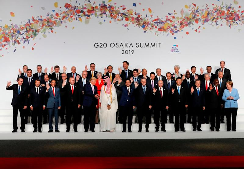 The family photo at the G20 Summit in Osaka on June 28, 2019 (Photo by KIM KYUNG-HOON / POOL / AFP): AFP/Getty Images