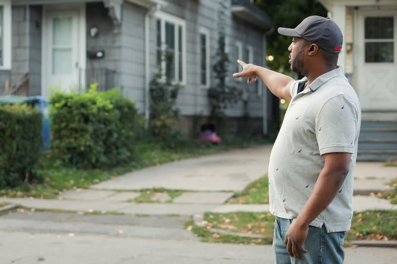 Silvon Simmons points to driveway where he was shot by police in Rochester, New York